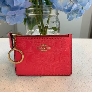 Beautiful Coach neon pink embossed card case!